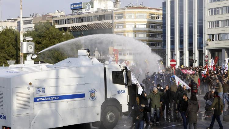Turkish riot police use water cannons against protesters during a demonstration against Turkey's ruling Ak Party (AKP) and Prime Minister Tayyip Erdogan, in Istanbul