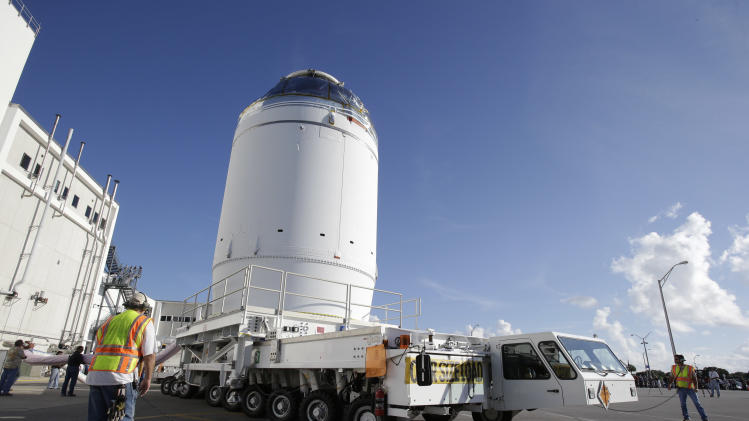 NASA's Orion spacecraft, preparing for it's first flight, departs the Neil Armstrong Operations and Checkout Building on its way to the Payload Hazardous Servicing Facility at the Kennedy Space Center, Thursday, Sept. 11, 2014, in Cape Canaveral, Fla. Orion is scheduled for a test flight in early December. (AP Photo/John Raoux)