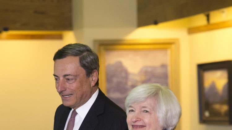 U.S. Federal Reserve Chair Yellen walks with European Central Bank President Draghi at the Jackson Hole Economic Policy Symposium in Jackson Hole