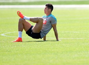 Portugal's forward and captain Cristiano Ronaldo stretches before training on June 7. (AFP)