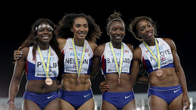 Britain's 4x100 relay team celebrate with their silver medals on the podium after placing second in the event at the IAAF World Relays Championships in Nassau