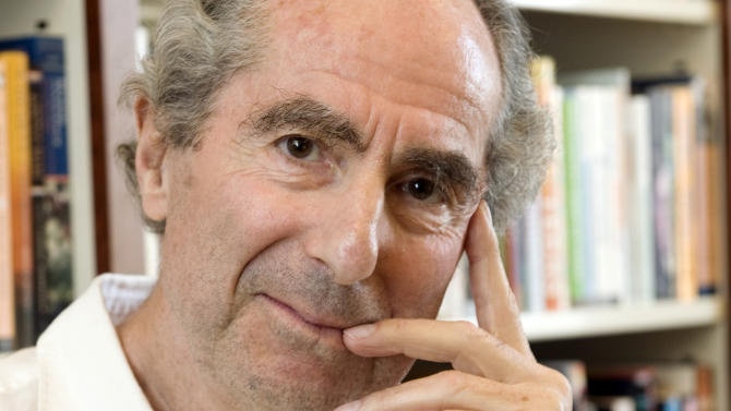 "FILE - In this Sept. 8, 2008 file photo, author Philip Roth poses for a photo in the offices of his publisher Houghton Mifflin, in New York. On Tuesday night, April 30, 2013 Roth received the PEN/Allen Foundation Literary Service Award. He was cited for such novels as ""Sabbath's Theater"" and ""American Pastoral,"" but also for his advocacy in the 1970s and 1980s for writers in Czechoslovakia and other Eastern bloc countries during the Cold War. PEN is an international writers' organization that advocates for human rights and free speech. (AP Photo/Richard Drew, file)"