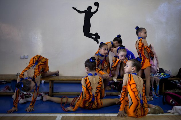 In this Nov. 9, 2012 photo, gymnasts from Russian-speaking immigrant families warm up at a gymnastics competition organized for Israel's immigrant community, in the southern resort city of Eilat. Most