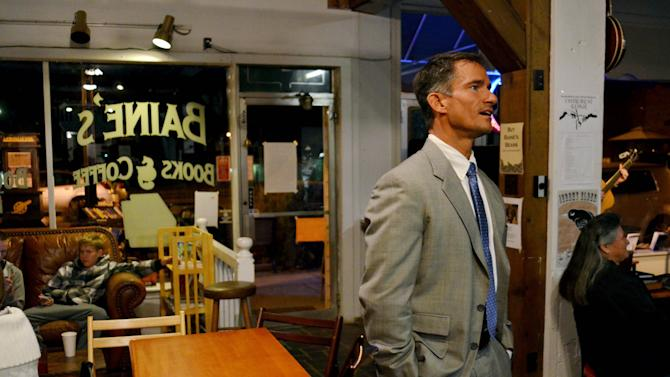 "In this Thursday, Nov. 8, 2012 photo, Michael Brickhill looks for his friend, Bryan Baine, at Baine's Books in Appomattox, Va. Brickhill finds his community in nearby Lynchburg, Va. polarized along religious lines, certainly, but also ""politically, socially, socio-economically. We're polarized by our affinity for local collegiate teams. It's either Virginia or Virginia Tech, and we are on the dividing line here."" (AP Photo/Pat Jarrett)"