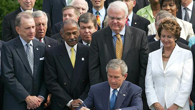 FILE This July 27, 2006 file photo shows President George W. Bush, center, surrounded by members of Congress signing legislation extending for 25 years the Voting Rights Act, on the South Lawn at the White House in Washington. Three years ago, the Supreme Court warned there could be constitutional problems with a landmark civil rights law that has opened voting booths to millions of African-Americans. Now, opponents of a key part of the Voting Rights Act are asking the high court to finish off that provision. Front row, from left are, Sen. Arlen Specter, R-Pa., Rep. John Conyers, D-Mich., Rep. James Sensenbrenner, R-Wis., and Rep. Nancy Pelosi, D-Calif. (AP Photo/Ron Edmonds, File)