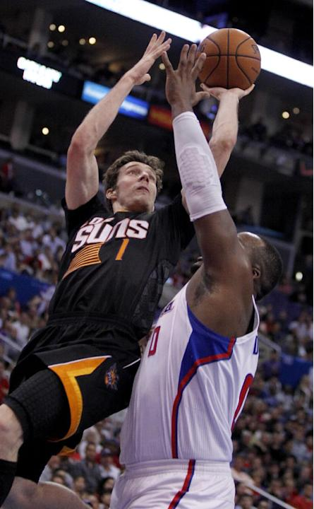 Phoenix Suns guard Goran Dragic (1), of Slovenia shoots over Los Angeles Clippers forward Glen Davis, right, during the second half of an NBA basketball game Monday, March 10, 2014, in Los Angeles. Cl