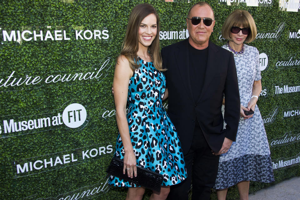 Actress Hilary Swank, from left, designer Michael Kors and Anna Wintour arrive at the 2013 Couture Council Award Luncheon at Lincoln Center on Wednesday, Sept. 4, 2013 in New York. (Photo by Charles Sykes/Invision/AP)