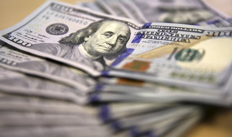 Dollar hits highest since March, world stocks mixed