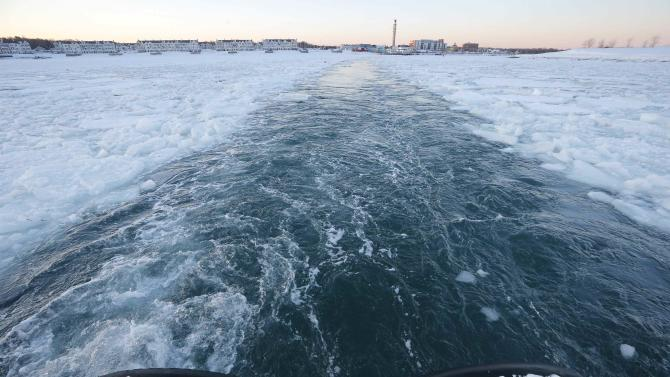 The Warren Jr. cuts a path through the ice as it works as an ice breaker for the commuter ferry in the waters off Hingham