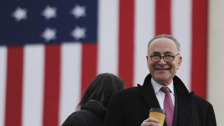 Sen. Charles Schumer, D-N.Y., arrives at the U.S. Capitol for the ceremonial swearing-in of President Barack Obama  during the 57th Presidential Inauguration in Washington, Monday, Jan. 21, 2013. (AP Photo/Susan Walsh)