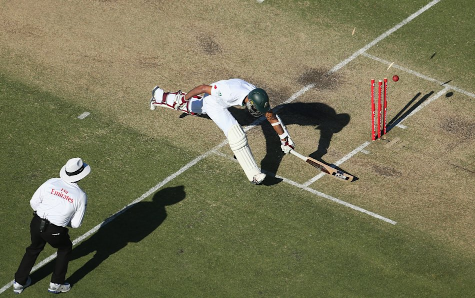 PERTH, AUSTRALIA - DECEMBER 01: Hashim Amla of South Africa survives a run out attempt during day two of the Third Test Match between Australia and South Africa at WACA on December 1, 2012 in Perth, A