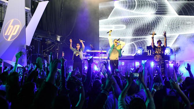 In this photo provided by HP, Far East Movement performs to celebrate the launch of HP's new line of Windows 8 touch-technology products Wednesday, Oct. 24, 2012 in New York. On Thursday in New York, Microsoft will unveil a dramatic overhaul of its ubiquitous Windows operating system. (AP Photo/HP)