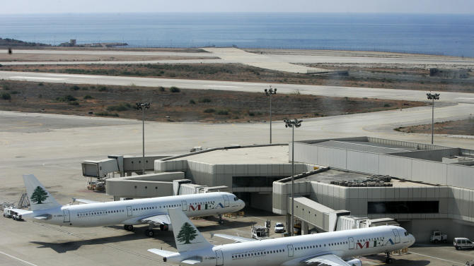 """In this Oct. 7, 2005 photo, Lebanon's Middle East Airlines airplanes are parked at Rafik Hariri international airport, in Beirut, Lebanon. Lebanon's national airline says it has disciplined an employee after a passenger complained on Facebook and Twitter that ground staff singled out passengers from the Philippines at the Beirut airport and told them over the loudspeaker: """"Filipino people, stop talking."""" (AP Photo/Hussein Malla)"""