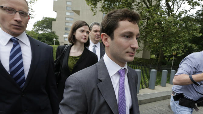 Former Goldman Sachs vice president Fabrice Tourre, right, walks to Manhattan federal court with his attorneys, in New York, Thursday, Aug. 1, 2013. Tourre's three-week trial stems from allegations the Securities and Exchange Commission made in 2010 against him and Goldman Sachs. It has been called the most significant legal action related to the mortgage securities crisis that helped push the country into recession. (AP Photo/Richard Drew)
