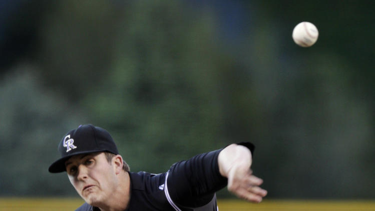Colorado Rockies starting pitcher Drew Pomeranz throws against the New York Mets in the first inning of their baseball game in Denver on Friday, April 27, 2012. (AP Photo/Joe Mahoney)