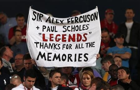 Manchester United fans hold up a message before their English Premier League soccer match against West Bromwich Albion at The Hawthorns