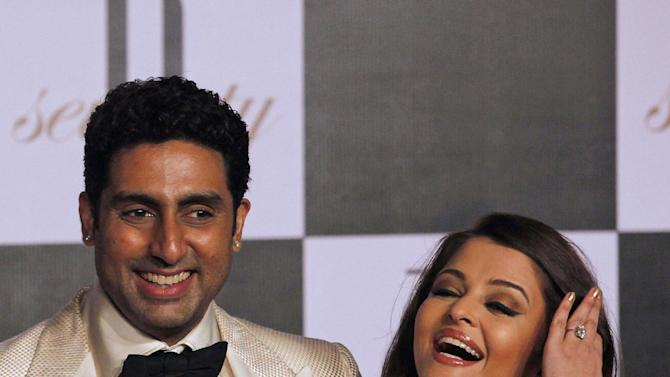 """Bollywood star Abhishek Bachchan, left, and his wife Aishwarya Rai-Bachchan attends a party to celebrate the 70th birthday of Bachchan's father Amitabh Bachchan in Mumbai, India, Wednesday, Oct. 10, 2012. Affectionately known as """"Big B,"""" Amitabh Bachchan has acted in around 180 films in a career spanning four decades in Bollywood, the home of India's prolific movie industry. (AP Photo/ Rajanish Kakade)"""