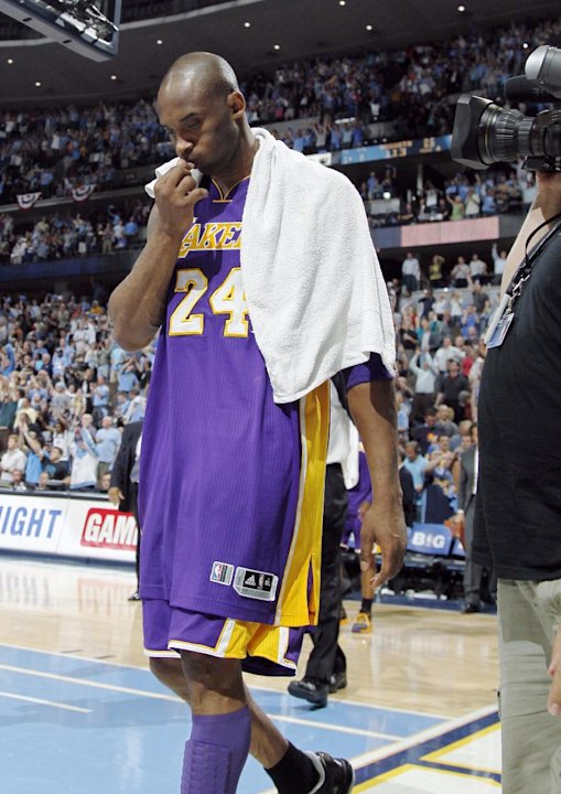 Los Angeles Lakers guard Kobe Bryant walks off the court after the Denver Nuggets' 113-96 victory in Game 6 of the teams'  first-round NBA basketball series in Denver on Thursday, May 10, 2012. Bryant