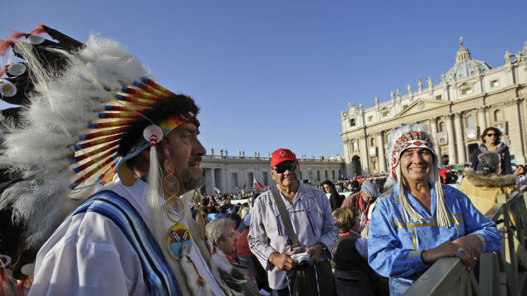 Native Americans wait for the start of a canonization ceremony celebrated by Pope Benedict XVI, in St. Peter's Square, at the Vatican, Sunday, Oct. 21, 2012. The pontiff will canonize seven people, Kateri Tekakwitha, the first Native American saint from the U.S., Maria del Carmen, Pedro Calungsod, Jacques Berthieu, Giovanni Battista Piamarta, Mother Marianne Cope, and Anna Shaeffer. (AP Photo/Andrew Medichini)