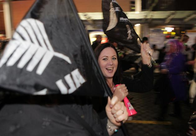 New Zealand rugby union fans crowd the streets during the opening game of the 2011 Rugby World Cup between New Zealand and Tonga in Auckland on September 9, 2011. The 2011 Rugby World Cup held in New