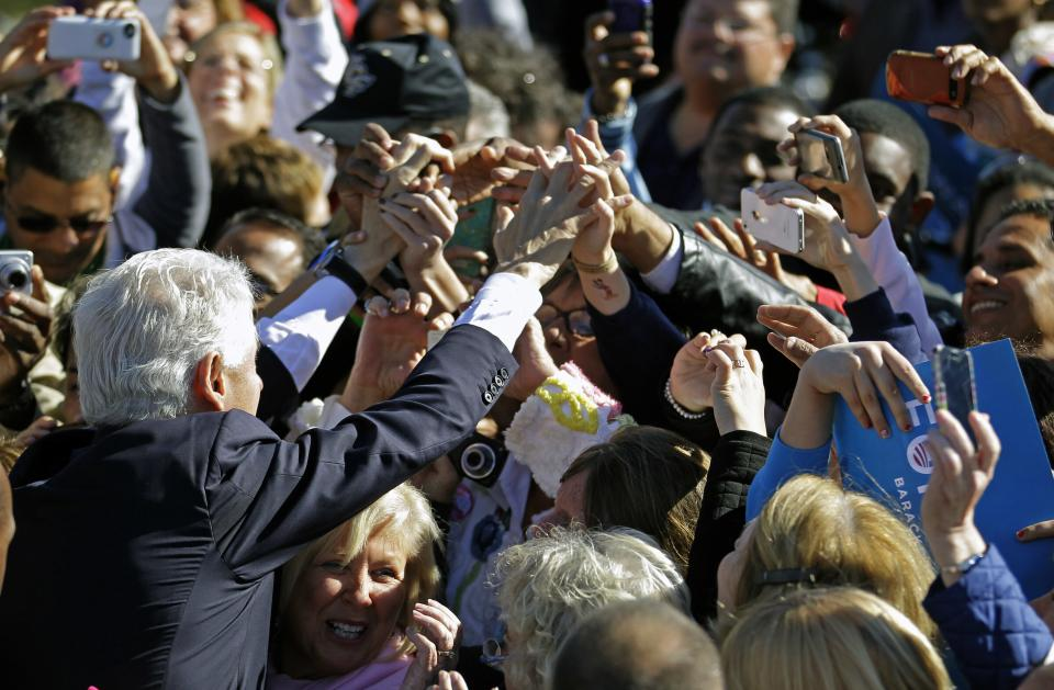 Former President Bill Clinton greets supporters after speaking at a campaign rally for President Barack Obama at the University of Central Florida, Monday, Oct. 29, 2012, in Orlando, Fla. President Obama cut short this Florida stop to head back to Washington to monitor Hurricane Sandy. (AP Photo/John Raoux)