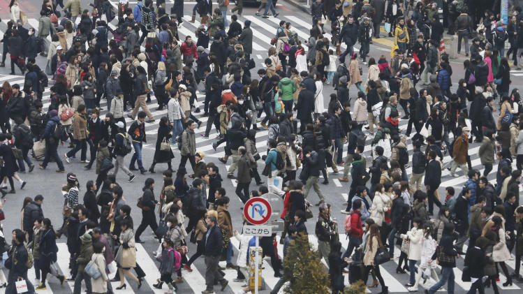 In this photo taken Jan. 25, 2014, people cross streets at Tokyo's shopping and entertainment district of Shibuya. Japan's consumer price index rose 0.4 percent in 2013, the first increase in five years, in further evidence the recovery in the world's third-largest economy is gaining momentum. (AP Photo/Koji Sasahara)