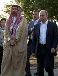 Jordan's Prince Ghazi (L) and Russian President Vladimir Putin (R) attend a ceremony for opening a guesthouse for Russia's Christian pilgrims at a Jordan Valley site where many Christians believe Jesus was baptised