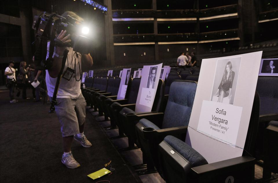 A cameraman films a placard showing where actress Sofia Vergara will sit for Sunday's 65th Emmy Awards telecast during Emmy Awards Press Preview Day, on Wednesday, Sept. 18, 2013, at Nokia Theatre in Los Angeles. (Photo by Chris Pizzello/Invision/AP)