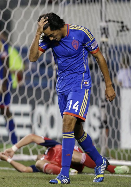 Colorado Rapids midfielder Tony Cascio reacts after missing a goal against the Chicago Fire during the second half of an MLS soccer match in Bridgeview, Ill., Wednesday, June 19, 2013. The Chicago Fir