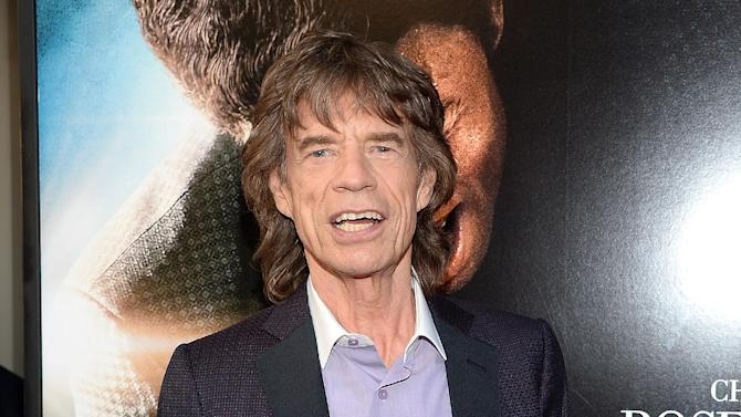 """FILE - In this July 21, 2014 file photo shows musician and producer Mick Jagger at the world premiere of the film """"Get On Up"""" at the Apollo Theater in New York. Mick Jagger is behind another James Brown project, the documentary, """"Mr. Dynamite: The Rise of James Brown,"""" which airs Monday, Oct. 27, on HBO. (Photo by Evan Agostini/Invision/AP, File)"""