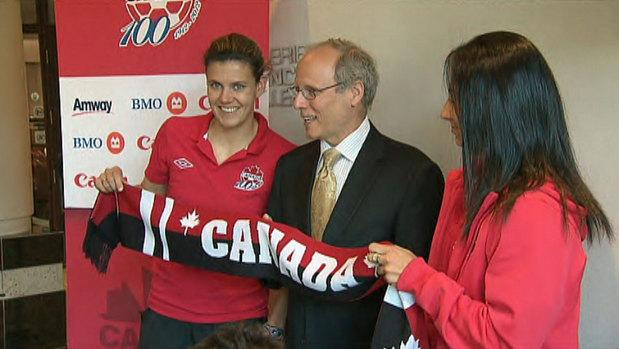 Christine Sinclair, George LeBlanc and Marie-Eve Nault celebrate the arrival of the Women's National Soccer Team to Moncton.