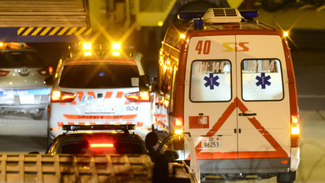 Police vehicles escort the ambulance carrying a Cuban doctor who contracted Ebola at the Geneva Airport before it heads from the airport to the university hospital HUG in Geneva, Switzerland, Thursday evening, Nov. 20, 2014. The medic, a member of the 165-member Cuban medical team sent to fight Ebola in Sierra Leone has been diagnosed with the disease, and was transferred to Geneva for treatment. (AP Photo/Keystone, Laurent Gillieron)