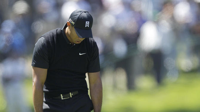 Tiger Woods drops his club after a shot on the sixth hole during the second round of the U.S. Open Championship golf tournament Friday, June 15, 2012, at The Olympic Club in San Francisco. (AP Photo/Ben Margot)