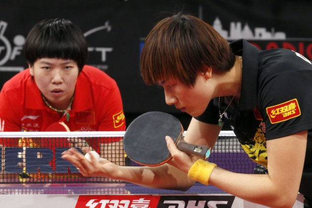 China's Ding prepares to serve to compatriot Li in their women's singles semi-final match at the World Team Table Tennis Championships in Paris