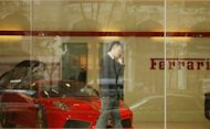 Photo illustration shows a man at a Ferrari dealership in Beijing. Recent scandals in China touch on the huge wealth amassed by many senior leaders in China -- a highly controversial issue in a country where tens of millions still live below the poverty line
