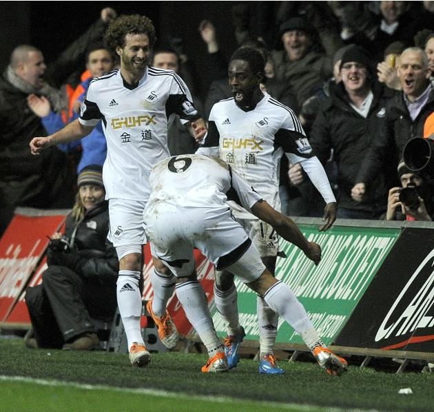 Swansea City's Nathan Dyer celebrates scoring a goal against Cardiff City during their English Premier League soccer match at the Liberty Stadium in Swansea
