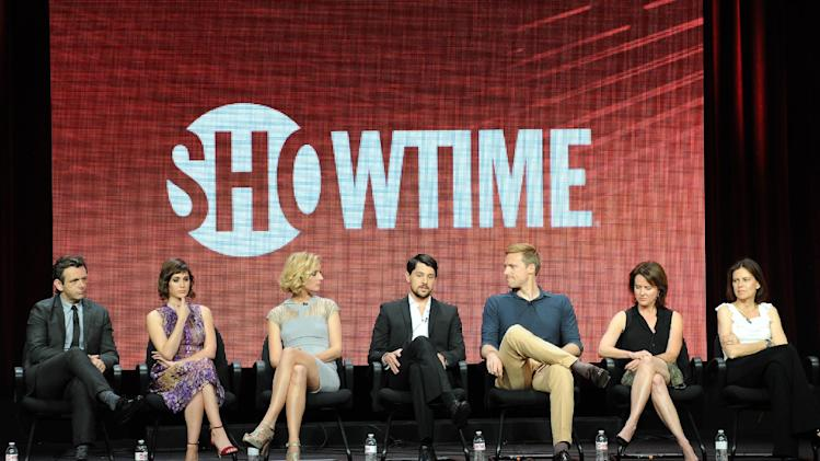 "From left, actors Michael Sheen, Lizzy Caplan, Caitlin Fitzgerald, Nicholas D'Agosto, Teddy Sears and executive producer Sarah Timberman and executive producer/writer Michelle Ashford participate in the ""Masters of Sex"" panel at the 2013 Showtime Summer TCA Press Tour at the Beverly Hilton Hotel on Tuesday, July 30, 2013 in Beverly Hills, Calif. (Photo by Frank Micelotta/Invision/AP)"