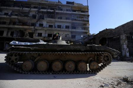 Syrian government forces press attack in east Aleppo