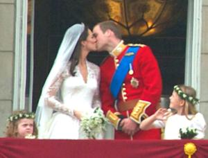 Prince William & Kate Middleton kiss on the Buckingham Palace balcony.