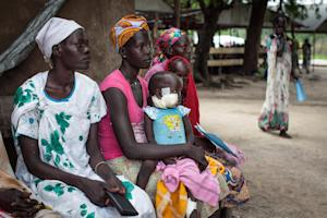 Families with malnourished children wait to receive …