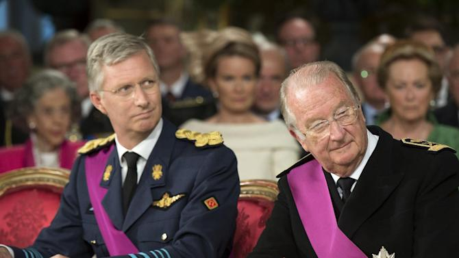 In this photo released by the Belgian Prime Ministers Office, Belgium's King Albert II, right and his son Prince Philippe listen to comments prior to the King signing the Act of Abdication during a ceremony at the Palace of the Nation in Brussels on Sunday, July 21, 2013. Philippe will take the oath before parliament to become Belgium's seventh king after his father Albert II abdicated as the head of this fractured nation. Earlier Sunday, the 79-year-old Albert signed away his rights as the kingdom's largely ceremonial ruler at the royal palace in the presence of Prime Minister Elio Di Rupo, who holds the political power in this 183-year-old parliamentary democracy. (AP Photo/Belgium Prime Ministers Office, HO)