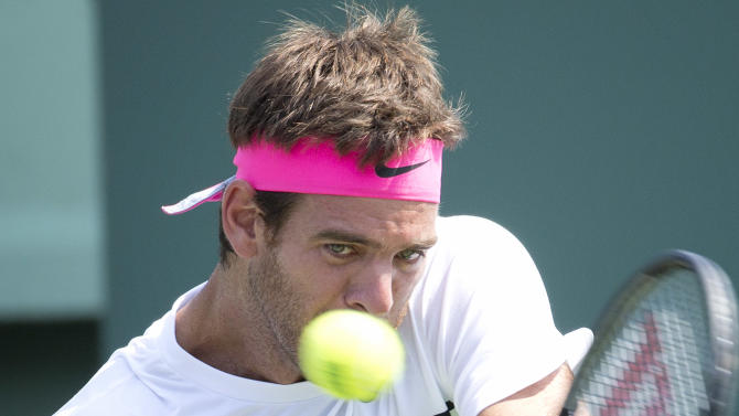 Juan Martin del Potro, of Argentina, hits a return against Vasek Pospisil, of Canada, during their match at the Miami Open tennis tournament in Key Biscayne, Fla., Thursday, March 26, 2015. (AP Photo/J Pat Carter)