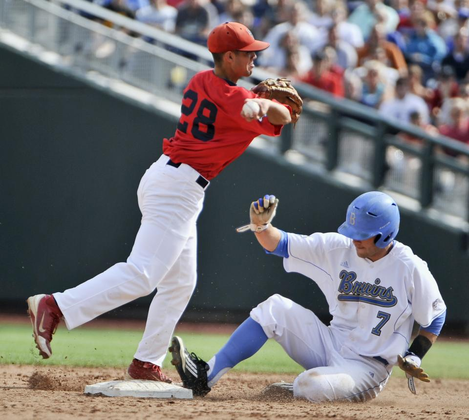 Stony Brook shortstop Cole Peragine (28) forces out UCLA's Cody Keefer on a ball hit by Jeff Gelalich, who was safe at first in the second inning of an NCAA College World Series baseball game in Omaha, Neb., Friday, June 15, 2012. (AP Photo/Eric Francis)
