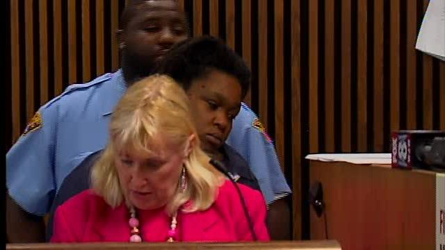 Noon: $1M bond for woman charged in stabbing