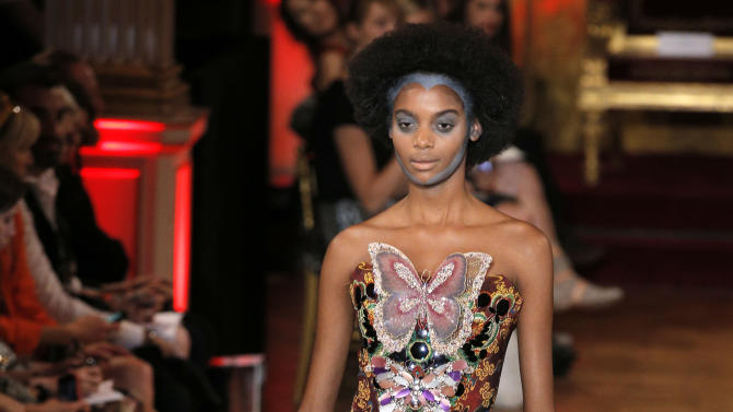 A model wears a creation for British fashion designer Vivienne Westwood's ready to wear Spring-Summer 2013 collection, presented in Paris, Saturday, Sept.29, 2012. (AP Photo/Francois Mori)