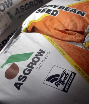 Bags of Asgrow soybean seed, a product of Monsanto, are displayed at a farm and grain dealer Tuesday, June 28, 2011, in West Alton, Mo. Monsanto Co. said Wednesday, June 29, higher sales of genetically engineered seeds helped it nearly double its third-quarter profit.(AP Photo/Jeff Roberson)