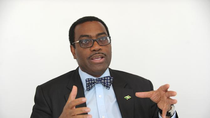 Nigerian Agriculture Minister and candidate for next president of the African Development Bank, Akinwumi Adesina, talks to the media in Paris on March 25, 2015