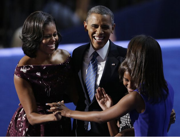 President Barack Obama laughs with his wife Michelle and his daughters Malia and Sasha after his speech to the Democratic National Convention in Charlotte, N.C., on Thursday, Sept. 6, 2012. (AP Photo/