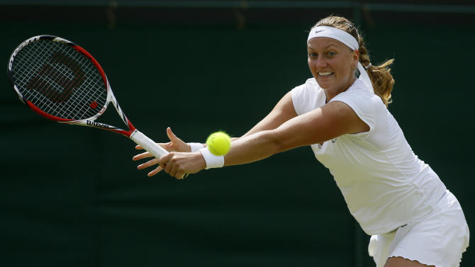Petra Kvitova of the Czech Republic returns to Carla Suarez Navarro of Spain during their Women's singles match at the All England Lawn Tennis Championships in Wimbledon, London, Monday, July 1, 2013. (AP Photo/Kirsty Wigglesworth)