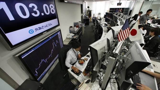 Money traders work under a screen indicating the U.S. dollar is traded at 103.08 yen at a foreign exchange company in Tokyo, Thursday, May 23, 2013. The dollar fell to 103 yen level. (AP Photo/Shizuo Kambayashi)